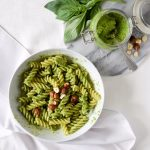 overhead shot of pesto pasta with hazelnuts