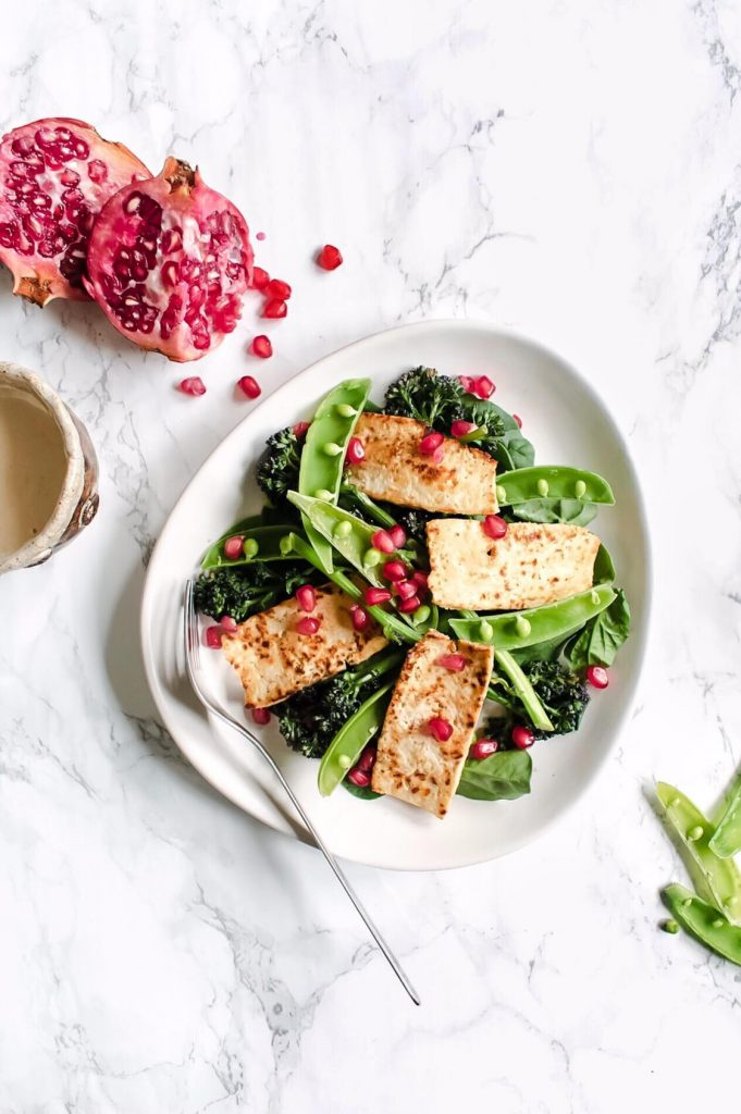 overhead photograph of tofu halloumi salad on a plate with a fork