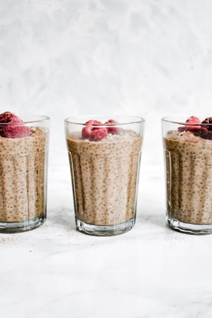 side photograph of three glasses of chia pudding