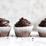 side photograph of three cupcakes