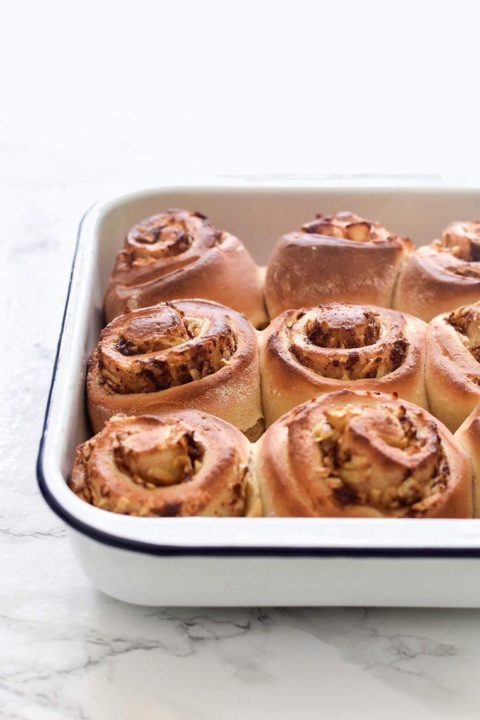 a side photograph of some cinnamon rolls in a dish
