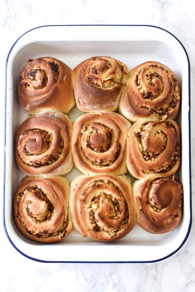 9 cinnamon rolls in a dish, after baking