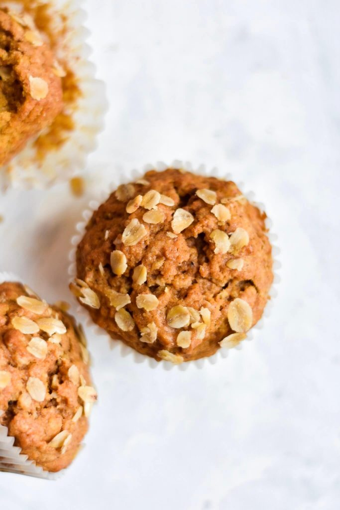overhead photograph of a muffin topped with oats