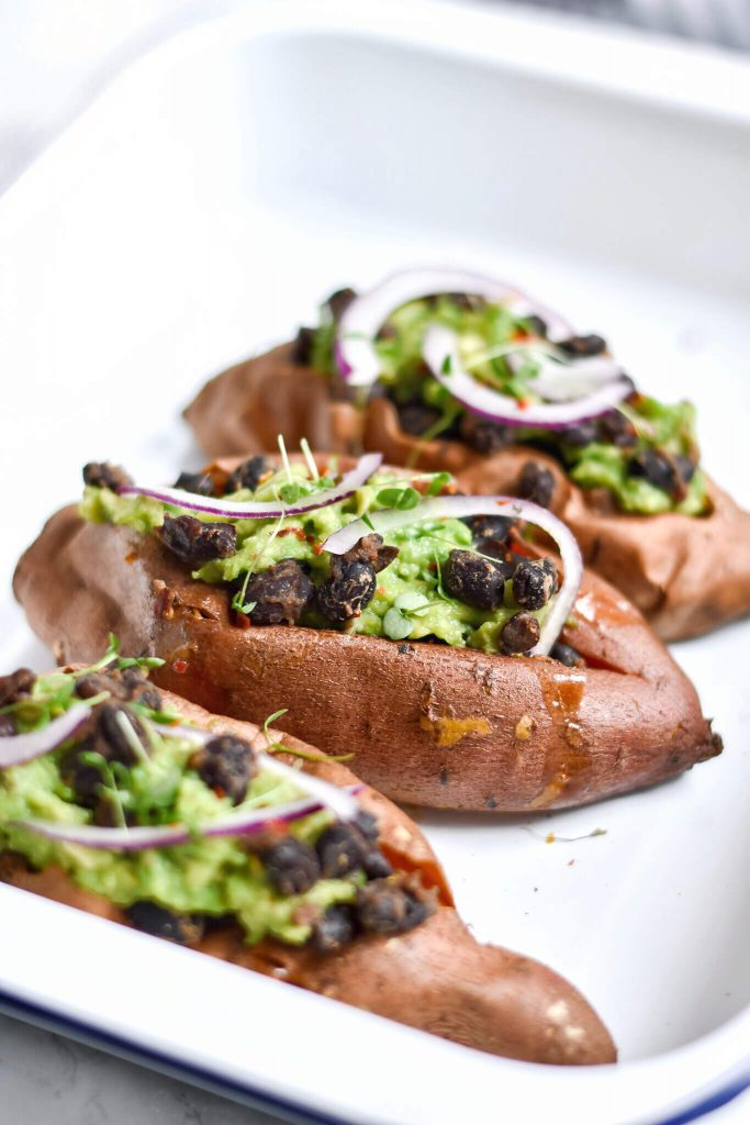 close up of a sweet potato stuffed with black beans
