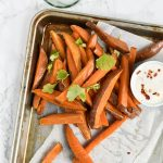 baked sweet potato fries on a tray