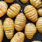 cooked hassleback potatoes up close