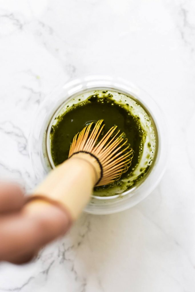 matcha whisk in a bowl with matcha