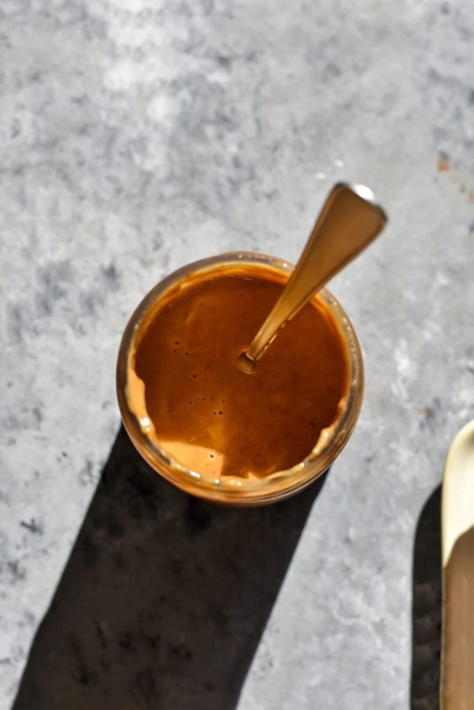 a close up of some almond butter in a jar