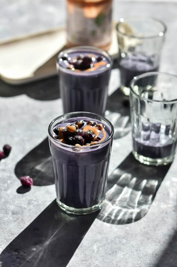 4 glasses of blueberry almond butter smoothie