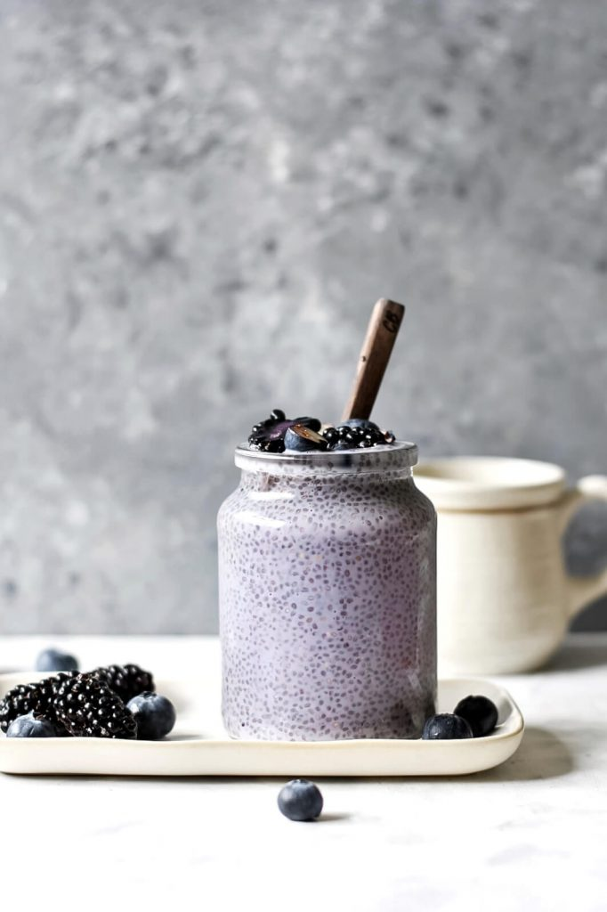 a jar of chia pudding topped with berries