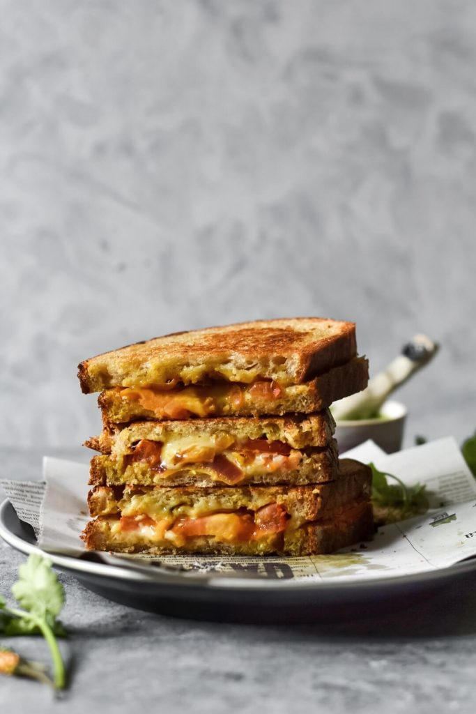 three masala grilled cheese sandwiches stacked on top of each other