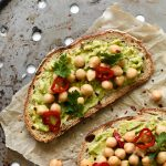 avocado toast topped with chickpeas and chilli
