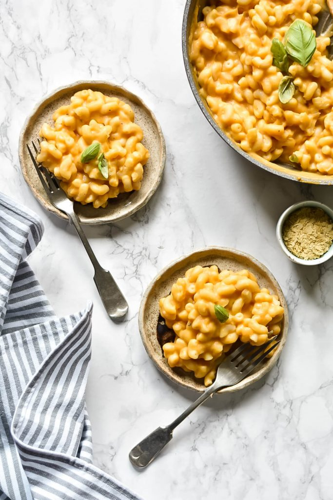 two plates of vegan mac and cheese