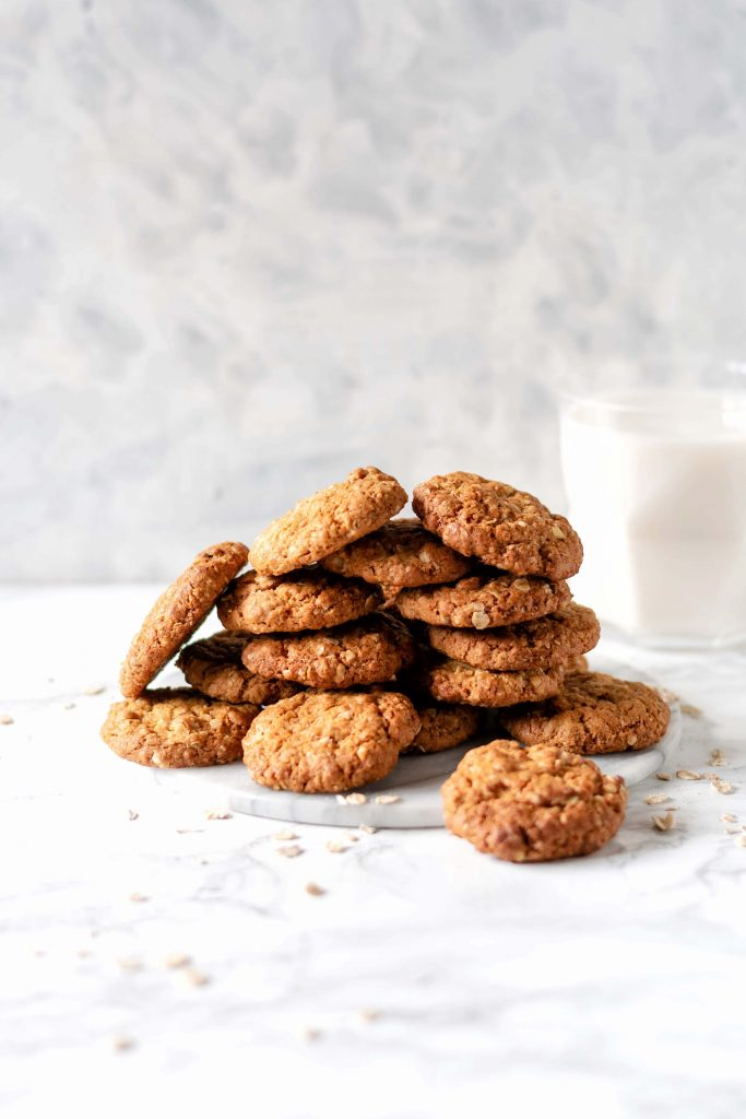 a pile of oat cookies on a marble board
