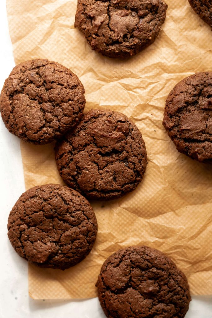 fudgy vegan chocolate cookies on some baking paper