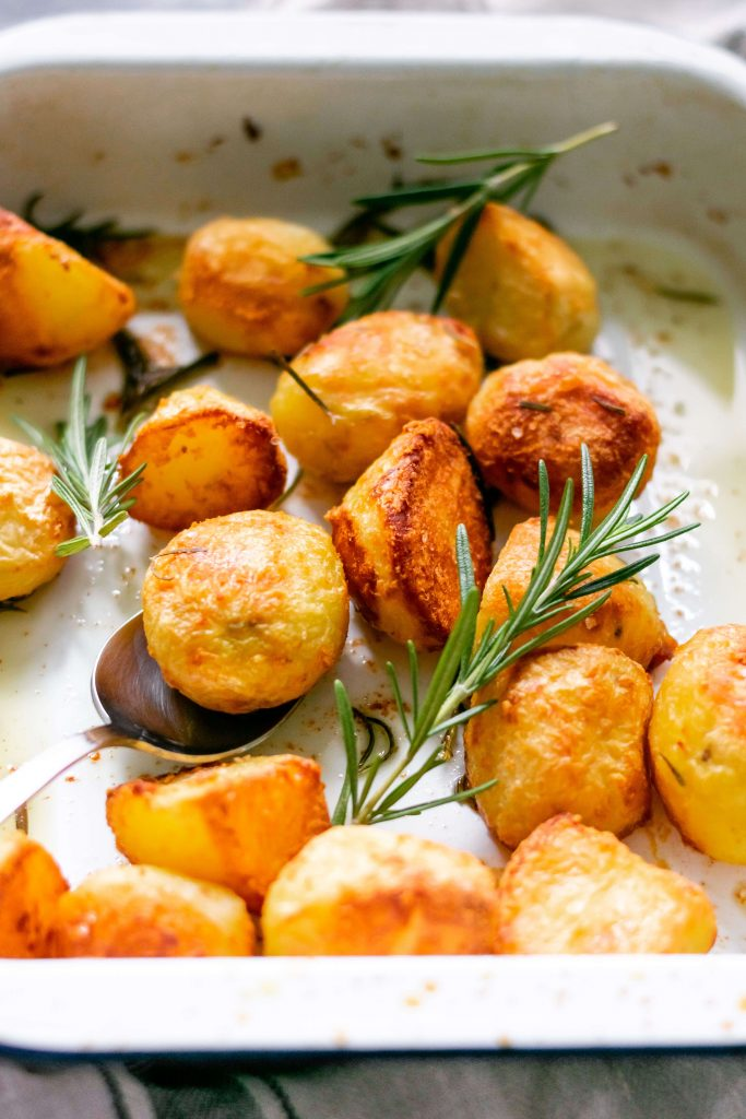 a side view of some crispy roasted potatoes with rosemary