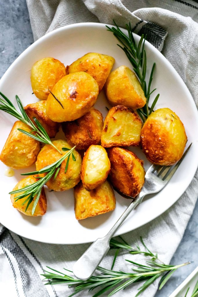 golden brown roasted potatoes on a plate