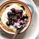 lemon blueberry baked oats in a dish with a spoon