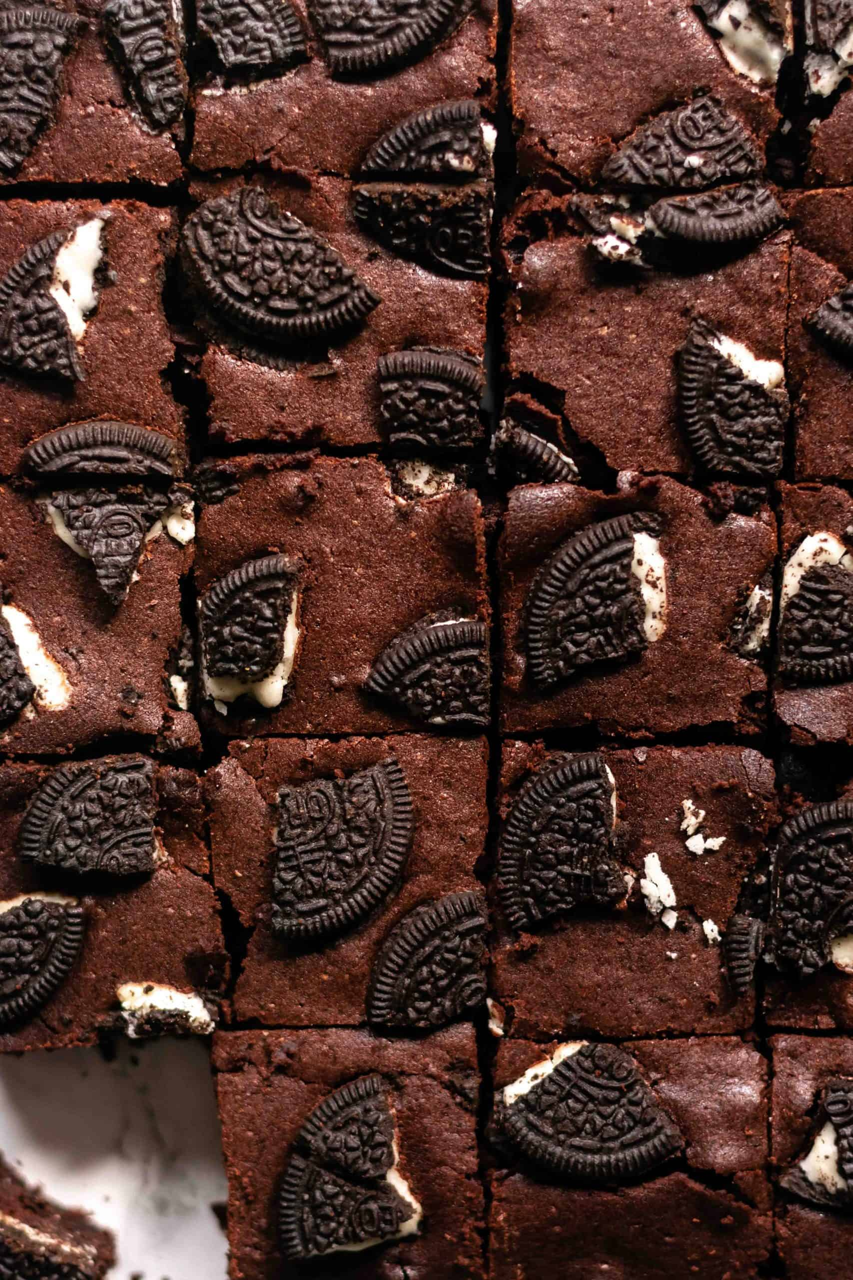 an overhead view of some sliced brownies with oreos on top